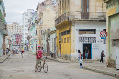 HAVANA, CUBA - DEC 4, 2015. People in an old decaying neighborhood Stock Photography