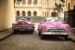 Two pink vintage car in Havana royalty free stock photography