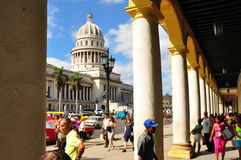 HAVANA, CUBA - DECEMBER 15 2014. Cubans walking in the center of Havana, after the US announced changes to its policy with Cuba Royalty Free Stock Photo