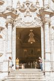 Entrance door to the Cathedral of Havana with the faithful inside during the Sunday Mass royalty free stock image