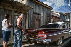Havana, CUBA - DECEMBER 10, 2014: Old classic American car park. On street of Havana,CUBA. Old American cars are iconic sight of Cuba street Royalty Free Stock Images