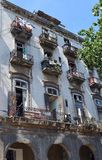Havana, Cuba: Different balconies, different lives. Havana, Cuba: windows and balconies on apartment block in Old Havana royalty free stock photos