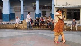 Couple of Cubans is dancing. HAVANA, CUBA - FEB 21, 2016: Couple of Cubans is dancing at the pedestrian zone of Paseo de Marti Prado avenue in Havana stock footage