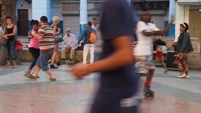 Cubans are dancing at the pedestrian zone. HAVANA, CUBA - FEB 21, 2016: Cubans are dancing at the pedestrian zone of Paseo de Marti Prado avenue in Havana stock footage