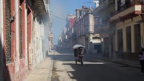 Houses of Havana are being fumigated. HAVANA, CUBA - FEB 24, 2016: Houses of Havana are being fumigated as a part of the fight against mosquitos carrying zika stock footage