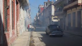 Houses of Havana are being fumigated. HAVANA, CUBA - FEB 24, 2016: Houses of Havana are being fumigated as a part of the fight against mosquitos carrying zika stock video footage