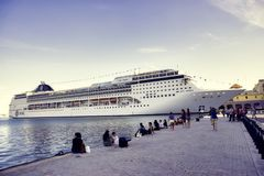 HAVANA, CUBA - FEB 17,2017 : The MSC Opera cruise ship docked at. The port of Havana showing the tourist boom the island has experienced in the last few years Royalty Free Stock Image
