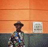 Havana, Cuba, February 12, 2018 : Adult black man waits at the entrance of Hambos Mundos Hotel stock photography