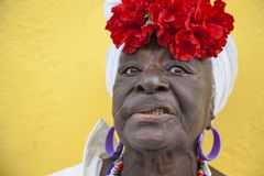 Havana, Cuba - 24 January 2013: Portraits of cuban people in traditional dresses. An elderly afro-cuban woman with a flowery headscarf stock photo