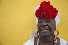 Havana, Cuba - 24 January 2013: Portraits of cuban people in traditional dresses. An elderly afro-cuban woman with a flowery headscarf royalty free stock photo