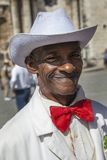 Havana, Cuba - 24 January 2013: Portraits of cuban people in traditional dresses. An elderly cuban man in a white suit and a red bow tie stock images