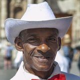 Havana, Cuba - 24 January 2013: Portraits of cuban people in traditional dresses. An elderly cuban man in a white suit and a red bow tie stock image