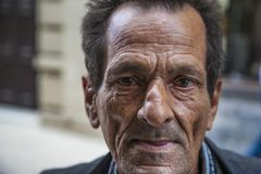 Havana, Cuba - 24 January 2013: Portraits of cuban people in traditional dresses. An elderly man with the wrinkles on his face. In a black suit royalty free stock photos