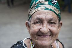 Havana, Cuba - 24 January 2013: Portraits of cuban people in traditional dresses. An elderly woman with the green headscarf royalty free stock photo