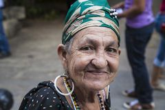 Havana, Cuba - 24 January 2013: Portraits of cuban people in traditional dresses. An elderly woman with the green headscarf royalty free stock photos