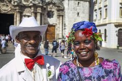 Havana, Cuba - 24 January 2013: Portraits of cuban people in traditional dresses. An older cuban couple in a traditional costume royalty free stock photography