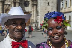 Havana, Cuba - 24 January 2013: Portraits of cuban people in traditional dresses. An older cuban couple in a traditional costume stock image