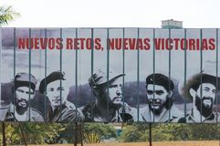 The propaganda poster. HAVANA, CUBA - JANUARY 16, 2017: The propaganda poster `New challenges, new victories` with faces of famous revolutionaries such as Fidel stock images