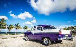 American blue white 1956 vintage car parked direct on the beach in Havana Cuba - Serie Cuba. Havana, Cuba - June 30, 2017: HDR - American blue Ford Fairlane stock images