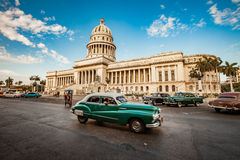 HAVANA, CUBA - JUNE 7, 2011: Old classic American car rides. In front of the Capitol Havana. Before a new law issued on October 2011, cubans could only trade Stock Photography