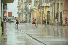 HAVANA, CUBA - MAY 31, 2013 Locan Cuban kids play football or so Royalty Free Stock Photo