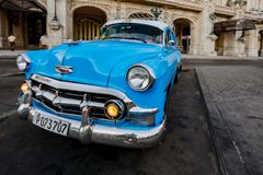 Blue Chevy is parked in front of Havana Opera House is parked in. Havana, Cuba, Nov 21, 2017 - Blue classic 1950`s Chevrolet is parked in front of Havana Opera royalty free stock image