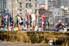 Fishermen at the famous Malecon seawall in Havana. HAVANA,CUBA - NOVEMBER 25,2017 : Fishermen at the famous Malecon seawall in Havana Stock Photos