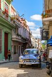 Old classic american car on a coloful street in Old Havana. HAVANA,CUBA - NOVEMBER 6, 2017 : Old classic american car on a coloful street in Old Havana Stock Image