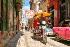 Urban scene on a narrow street in Old Havana. HAVANA,CUBA - NOVEMBER 6, 2017 : Urban scene on a narrow street in Old Havana Stock Images