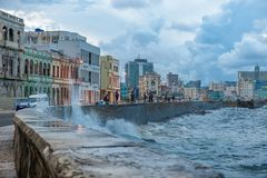 HAVANA, CUBA - OCTOBER 20, 2017: Havana Old Town and Malecon Area with Caribbean Sea Waves. Havana Old Town and Malecon Area with Caribbean Sea Waves Royalty Free Stock Images