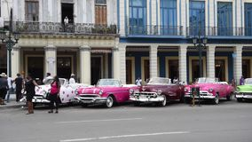 HAVANA, CUBA - OCTOBER 20, 2017: Havana Old Town with Tourist and Old Taxi Vehicle stock video footage