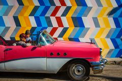 HAVANA, CUBA - OCTOBER 29, 2015 Old American cars are used as taxis for both locals and tourists on the streets of Old Havana, Hav. HAVANA, CUBA - OCTOBER 29 stock photo