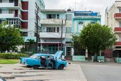 HAVANA, CUBA - OCTOBER 21, 2017: Old Car in Havana, Cuba. Local People Trying to Repair it. Stock Photo
