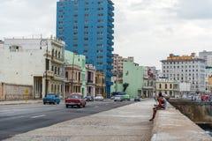 HAVANA, CUBA - OCTOBER 21, 2017: Old Car in Havana, Cuba. Malecon Avenue with Havana Cityscape. Old Car in Havana, Cuba. Malecon Avenue with Havana Cityscape Stock Photo