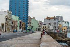HAVANA, CUBA - OCTOBER 21, 2017: Old Car in Havana, Cuba. Malecon Avenue with Havana Cityscape. Old Car in Havana, Cuba. Malecon Avenue with Havana Cityscape Royalty Free Stock Photo