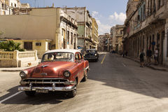 HAVANA,CUBA-OCTOBER 13:People and old car on streets of Havana O Royalty Free Stock Image