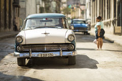 HAVANA,CUBA-OCTOBER 13:People and old car on streets of Havana O Royalty Free Stock Photography