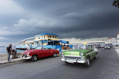 HAVANA,CUBA-OCTOBER 14:People and old car on streets of Havana O Royalty Free Stock Images