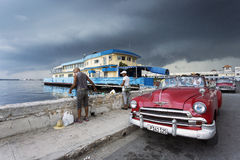 HAVANA,CUBA-OCTOBER 14:People and old car on streets of Havana O Stock Photography