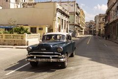 HAVANA,CUBA-OCTOBER 13:People and old car on streets of Havana O Royalty Free Stock Photo