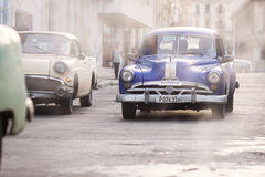 HAVANA,CUBA-OCTOBER 14:People and old car on streets of Havana O Stock Images