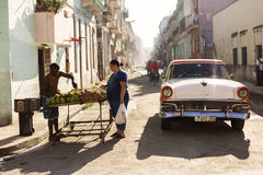 HAVANA,CUBA-OCTOBER 13:People and old car on streets of Havana O Stock Photos