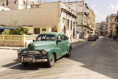 HAVANA,CUBA-OCTOBER 13:People and old car on streets of Havana O Stock Images