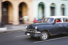 HAVANA,CUBA-OCTOBER 14:People and old car on streets of Havana O Royalty Free Stock Photos