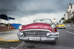 HAVANA,CUBA-OCTOBER 14:People and old car on streets of Havana O Royalty Free Stock Photography