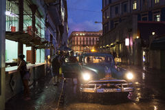 HAVANA,CUBA-OCTOBER 14:People and old car on streets of Havana O Stock Photos