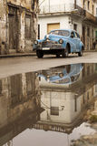 HAVANA,CUBA-OCTOBER 15:People and old car on streets of Havana O Royalty Free Stock Photography
