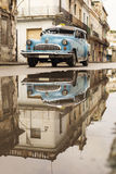 HAVANA,CUBA-OCTOBER 15:People and old car on streets of Havana O Stock Images