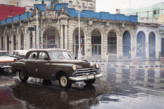 HAVANA,CUBA-OCTOBER 15:People and old car on streets of Havana O Stock Photography