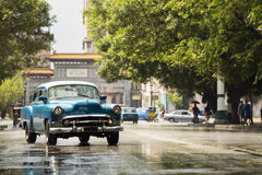 HAVANA,CUBA-OCTOBER 15:People and old car on streets of Havana O Royalty Free Stock Image